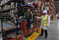 Boris Johnson, right, talks to a member of staff during his visit to Johnstone's Paints in Batley, West Yorkshire