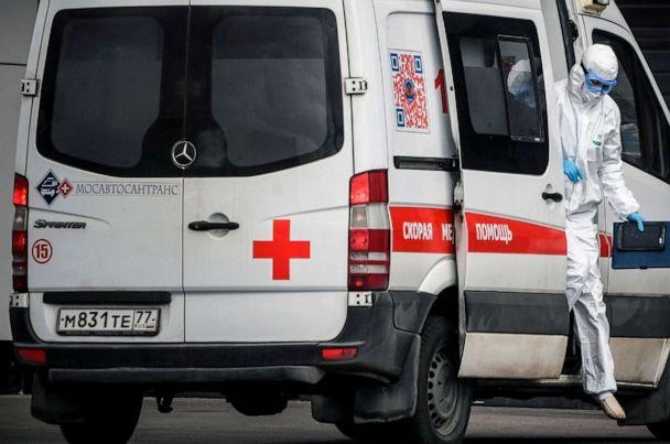 PHOTO: A medic gets out from an ambulance at a hospital where patients infected with the novel coronavirus are being treated in the settlement of Kommunarka, outside Moscow, Russia, on April 28, 2020. (Alexander Nemenov/AFP via Getty Images)