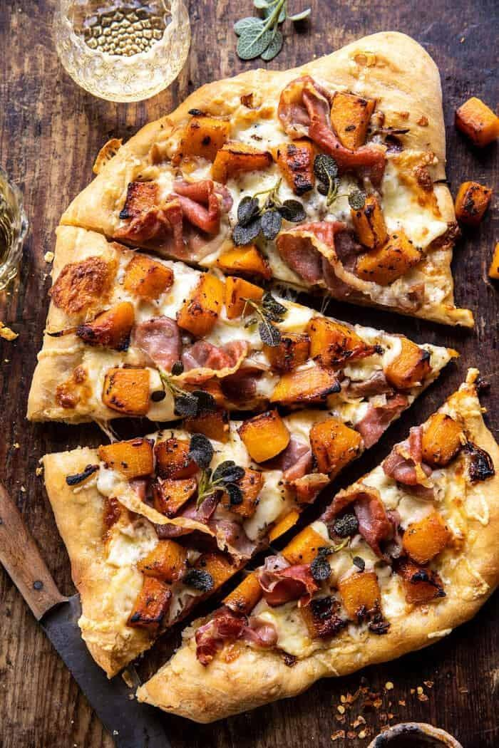 "Pizza is already pretty high up on the list of comforting foods so it doesn't take much convincing to include it here. Pairing roasty toasty butternut squash with prosciutto, sage and caramelised onions makes for the perfect autumnal weeknight meal.<br><br><strong><a href=""http://halfbakedharvest.com/butternut-squash-prosciutto-pizza/"" rel=""nofollow noopener"" target=""_blank"" data-ylk=""slk:Roasted Butternut Squash Prosciutto Pizza With Caramelised Onions"" class=""link rapid-noclick-resp"">Roasted Butternut Squash Prosciutto Pizza With Caramelised Onions</a> by Half Baked Harvest<br><br></strong>"