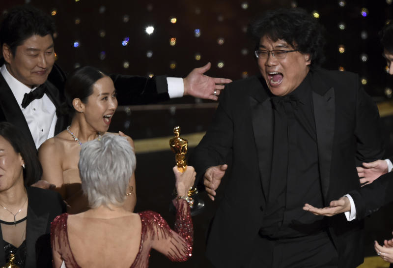 """Bong Joon Ho, right, reacts as he is presented with the award for best picture for """"Parasite"""" from presenter Jane Fonda at the Oscars on Sunday, Feb. 9, 2020, at the Dolby Theatre in Los Angeles. Looking on from left are Kang-Ho Song and Kwak Sin Ae.(AP Photo/Chris Pizzello)"""