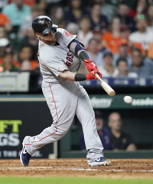 Boston Red Sox's Christian Vazquez hits a two-run single against the Houston Astros during the ninth inning of a baseball game Saturday, May 25, 2019, in Houston. (AP Photo/David J. Phillip)
