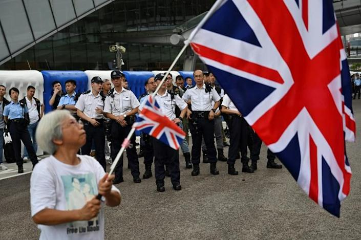 Alexandra Wong says she chooses to wave the Union Flag to express her dissatisfaction with the two decades of Beijing's rule over Hong Kong (AFP Photo/Hector RETAMAL)