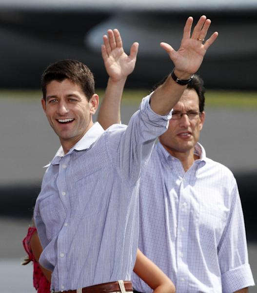 Republican vice presidential candidate Rep. Paul Ryan, R-Wis. and House Majority Leader Eric Cantor of Va. waves to the crowd during a rally at the airport in Richmond, Va., Friday, Aug. 31, 2012. ( AP Photo/Steve Helber)