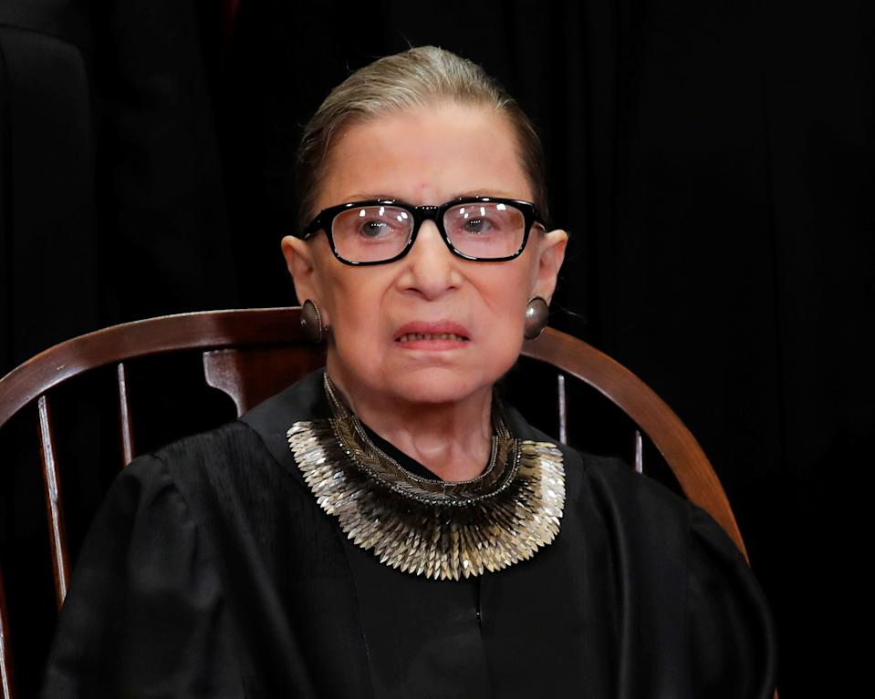 Justice Ginsburg is known for her elaborate collars and statement earrings. (Photo: REUTERS/Jim Young)