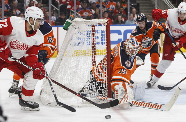 Detroit Red Wings' Andreas Athanasiou (72) is stopped by Edmonton Oilers goalie Mikko Koskinen (19) during third period NHL action in Edmonton on Tuesday, Jan. 22, 2019. (Jason Franson/The Canadian Press via AP)