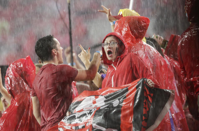 Fans at Memorial Stadium dance to music during a lightning and rain delay in the first half of an NCAA college football game between Nebraska and Akron in Lincoln, Neb., Saturday, Sept. 1, 2018. (AP Photo/Nati Harnik)