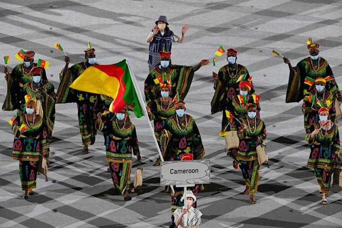 <p>Cameroon's delegation parade during the opening ceremony of the Tokyo 2020 Olympic Games, at the Olympic Stadium, in Tokyo, on July 23, 2021. (Photo by Martin BUREAU / AFP) (Photo by MARTIN BUREAU/AFP via Getty Images)</p>