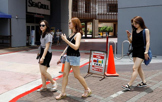 <p>Tourists stroll in the Tumon tourist district on the island of Guam, a U.S. Pacific Territory, August 10, 2017. (Erik De Castro/Reuters) </p>