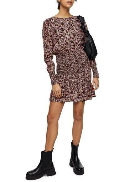 <p>This <span>Topshop Floral Shirred Long Sleeve Minidress</span> ($50, originally $75) looks just as good with Dr. Martens boots as it does with slide sandals.</p>