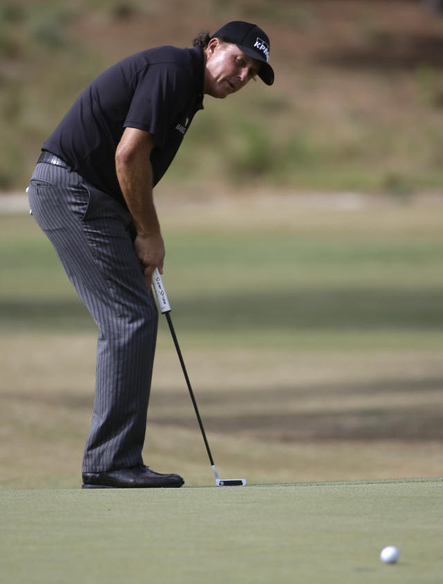Phil Mickelson putts on the 16th hole during the first round of the U.S. Open golf tournament in Pinehurst, N.C., Thursday, June 12, 2014. (AP Photo/David Goldman)