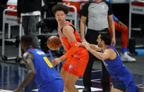 Oklahoma City Thunder center Isaiah Roby, center, looks to pass the ball as Denver Nuggets forward JaMychal Green, left, and guard Facundo Campazzo defend during the first half of an NBA basketball game Friday, Feb. 12, 2021, in Denver. (AP Photo/David Zalubowski)