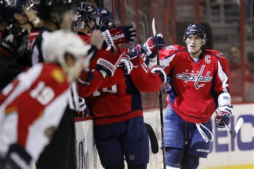 Washington Capitals left wing Alex Ovechkin, of Russia, right, celebrates with teammates after scoring a goal during the second period of an NHL hockey game against the Florida Panthers on Thursday, April 5, 2012, in Washington. (AP Photo/Evan Vucci)