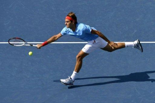 "World number one Roger Federer, pictured on September 1, made the US Open quarter-finals without hitting a ball when American opponent Mardy Fish withdrew due to ""health reasons"", a tournament spokesman said"