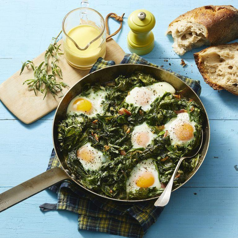 """<p>The lemony hollandaise provides the ideal creamy contrast to the spicy sautéed mustard greens and poached eggs in this healthy dish. """"Per one large egg,"""" Gorin says, """"you get eight essential nutrients including 6 grams of high-quality protein."""" </p><p><em><a href=""""https://www.womansday.com/food-recipes/a32320198/skillet-eggs-with-mustard-greens-and-hollandaise-recipe/"""" rel=""""nofollow noopener"""" target=""""_blank"""" data-ylk=""""slk:Get the Skillet Eggs With Mustard Greens and Hollandaise recipe."""" class=""""link rapid-noclick-resp"""">Get the Skillet Eggs With Mustard Greens and Hollandaise recipe.</a></em><br></p>"""