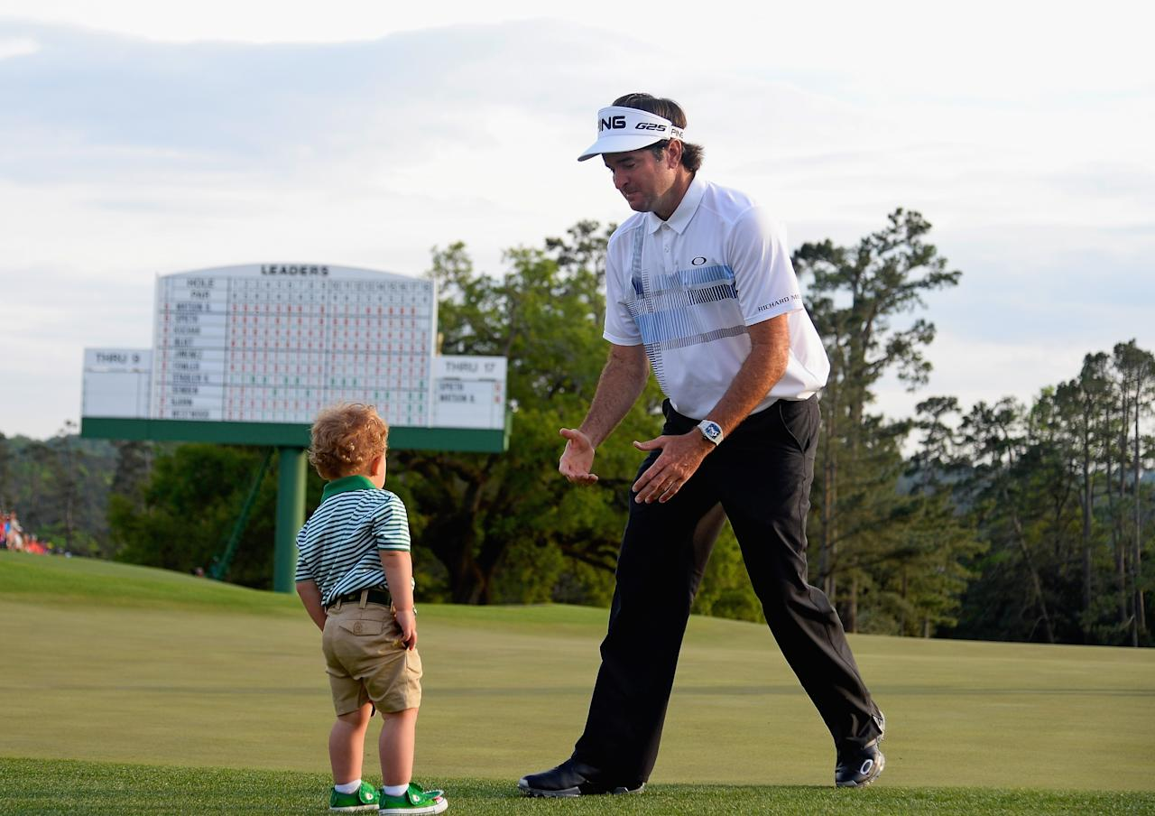 AUGUSTA, GA - APRIL 13: Bubba Watson of the United States walks towards his son Caleb on the 18th green after winning the 2014 Masters Tournament by a three-stroke margin at Augusta National Golf Club on April 13, 2014 in Augusta, Georgia. (Photo by Harry How/Getty Images)