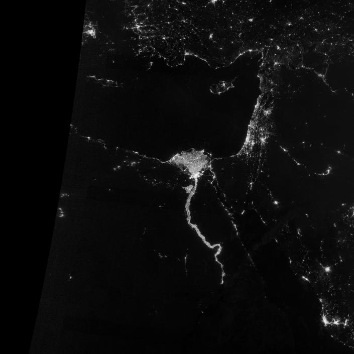 """On October 13, 2012, the Visible Infrared Imaging Radiometer Suite (VIIRS) on the Suomi NPP satellite captured this nighttime view of the Nile River Valley and Delta. This image is from the VIIRS """"day-night band,"""" which detects light in a range of wavelengths from green to near-infrared and uses filtering techniques to observe signals such as gas flares, auroras, wildfires, city lights, and reflected moonlight. (NASA)"""