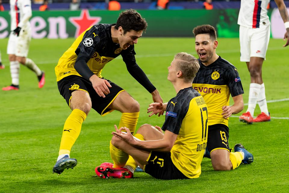 Erling Haaland (seated) and American teen Giovani Reyna (left) are two of many reasons to watch Borussia Dortmund and the Bundesliga when it returns this month. (DeFodi Images/Getty Images)