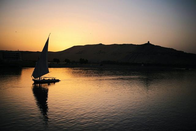 A pleasure boat carrying tourists and locals sails on the Nile River at sunset in Aswan, Egypt (Mosa'ab Elshamy/AP)