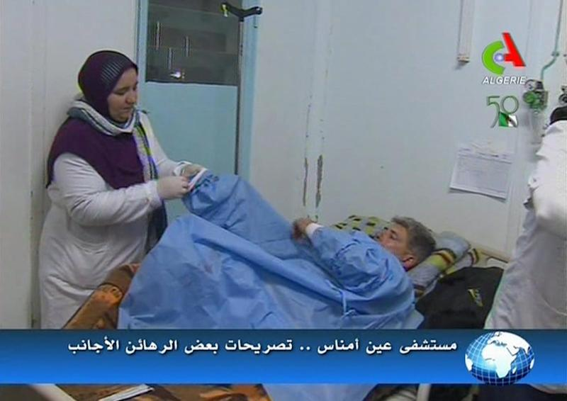 An unidentified rescued hostage receives treatment in a hospital in Ain Amenas, Algeria, in this image taken from television Friday Jan. 18, 2013. Algeria's state news service says nearly 100 out of 132 foreign hostages have been freed from a gas plant where Islamist militants had held them captive for three days. The APS news agency report was an unexpected indication of both more hostages than had previously been reported and a potentially breakthrough development in what has been a bloody siege. (AP Photo/Canal Algerie via Associated Press TV) ** TV OUT ALGERIA OUT **