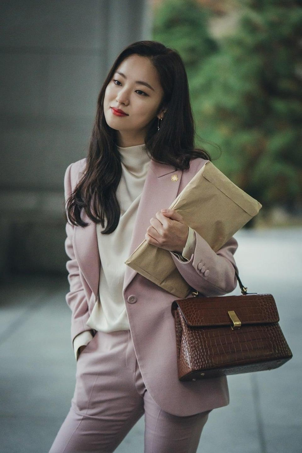 """<p>What else would you wear for your day in court taking down an evil, murderous pharmaceutical company but a cool pink power suit? Snap up the <a href=""""http://www.momokorea.com/women/outer-w/lwjkkj0200.html"""" class=""""link rapid-noclick-resp"""" rel=""""nofollow noopener"""" target=""""_blank"""" data-ylk=""""slk:Lynn wool blazer"""">Lynn wool blazer</a> ($658) and <a href=""""http://www.momokorea.com/women/womens-pants/lwslkj0200.html"""" class=""""link rapid-noclick-resp"""" rel=""""nofollow noopener"""" target=""""_blank"""" data-ylk=""""slk:pants"""">pants</a> ($418) for the next time you have to take down a baddie, Cha-Young style.</p>"""