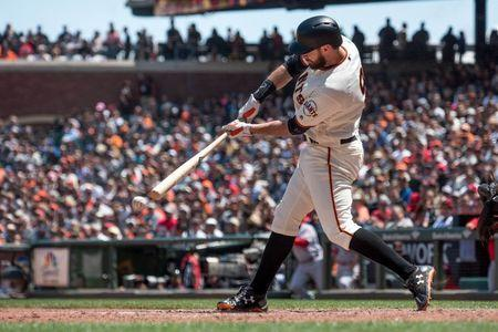 May 16, 2018; San Francisco, CA, USA; San Francisco Giants first baseman Brandon Belt (9) hits a single during the seventh inning of the game against the Cincinnati Reds at AT&T Park. Mandatory Credit: Ed Szczepanski-USA TODAY Sports