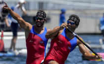 Serguey Torres Madrigal and Fernando Dayan Jorge Enriquez, of Cuba, react after competing in the men's canoe double 1000m final at the 2020 Summer Olympics, Tuesday, Aug. 3, 2021, in Tokyo, Japan. (AP Photo/Lee Jin-man)