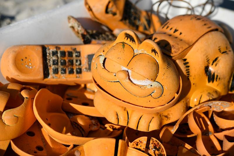 The group had long suspected a lost shipping container was to blame for the plastic pieces of the novelty landline phones, that have plagued the northern Finistere beaches (AFP Photo/Fred TANNEAU)