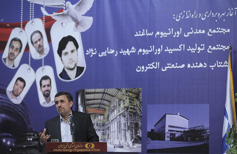 In this photo released by the official website of the office of the Iranian Presidency, President Mahmoud Ahmadinejad, speaks at a ceremony marking Iran's National Day of Nuclear Technology, in Tehran, Iran, Tuesday, April 9, 2013. Iran announced two key nuclear-related projects on Tuesday that expand the country's ability to extract and process uranium, which can be enriched for reactor fuel but also potentially for atomic weapons. Ahmadinejad ordered the symbolic start of operations through a video conference for Iran's National Day of Nuclear Technology, which marks the anniversary of the first time Iran enriched uranium in 2006. The portraits at center show Iran's slain nuclear scientists and workers. (AP Photo/Rouzbeh Jadidoleslam, Presidency Office)