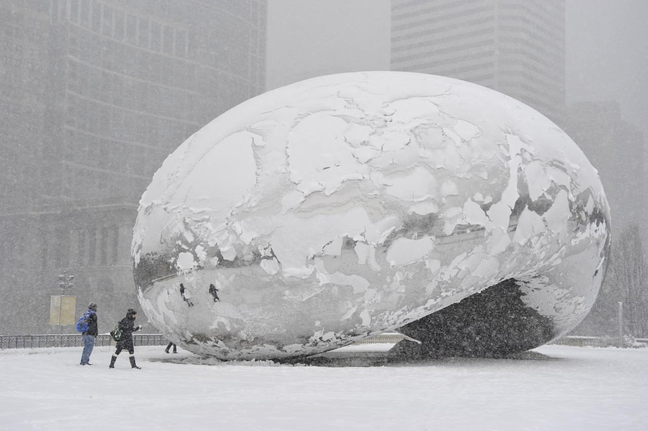 """CHICAGO, IL - MARCH 5:  The sculpture """"Cloud Gate"""", commonly known as """"the bean,"""" is covered in snow on March 5, 2013 in Chicago, Illinois. The worst winter storm of the season is expected to dump 7-10 inches of snow on the Chicago area with the worst expected for the evening commute.  (Photo by Brian Kersey/Getty Images)"""