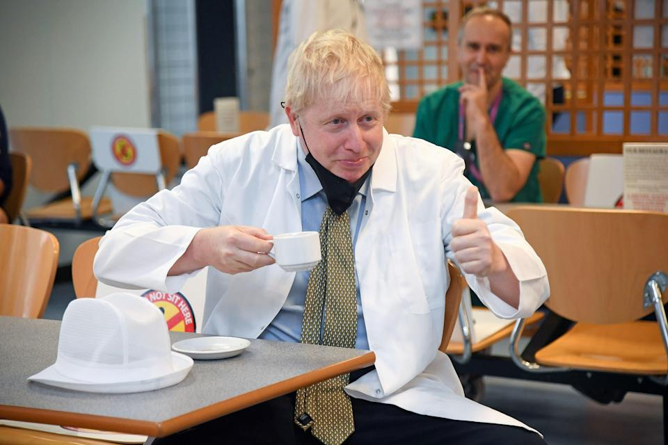 Boris Johnson visits a canteen in Reading earlier this week, as anger over free school meals intensifies (POOL/AFP via Getty Images)