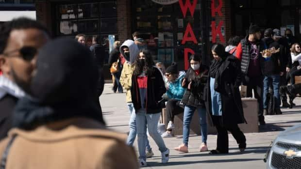 Pedestrians make their way through the ByWard Market on March 20, 2021. Many people descended on the market Saturday as temperatures hit 13 C. On Sunday, the city's health officials reported 86 new cases of COVID-19, as well as three more deaths.  (Olivier Plante/Radio-Canada - image credit)
