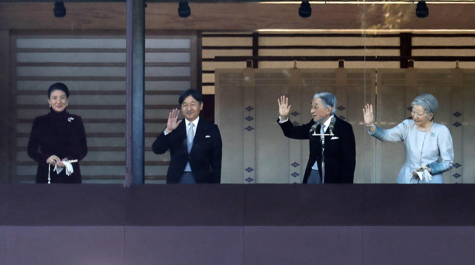 Japan's Emperor Akihito, second from right, waves with Empress Michiko, right, Crown Prince Naruhito and Crown Princess Masako to well-wishers from the balcony during his New Year's public appearance with his family members at Imperial Palace in Tokyo Wednesday, Jan. 2, 2019. Akihito waved Wednesday to throngs of well-wishers eager to see the final New Year's appearance in his reign. (AP Photo/Eugene Hoshiko)