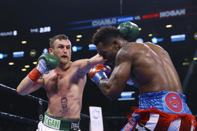 Ireland's Dennis Hogan punches Jermall Charlo during the fifth round of a WBC middleweight title boxing match Saturday, Dec. 7, 2019, in New York. (AP Photo/Michael Owens)