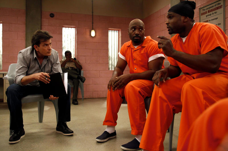 """This publicity image released by FX shows Charlie Sheen, left, with James Black and Darius McCrary, right, in a scene from the new comedy """"Anger Management.""""  The series, Sheen's latest since leaving """"Two and a Half Men,"""" premieres Thursday June 28, 2012 with a pair of back-to-back episodes at 9 p.m. on FX.  (AP Photo/FX, Greg Gayne)"""