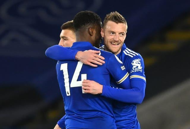 Leicester City's Kelechi Iheanacho (left) celebrates with with team-mate Jamie Vardy (right)
