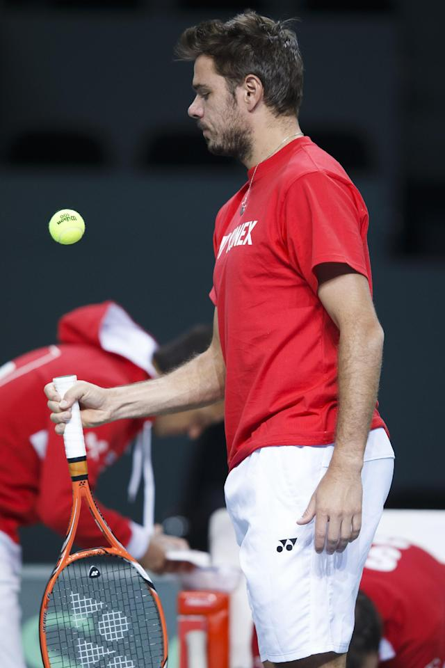 Stanislas Wawrinka, of Switzerland, plays with the ball during a training session of the Swiss Davis Cup team prior to the Davis Cup world group quarterfinal match between Switzerland and Kazakhstan, in Geneva, Switzerland, Tuesday, April 1, 2014. (AP Photo/Keystone,Salvatore Di Nolfi)