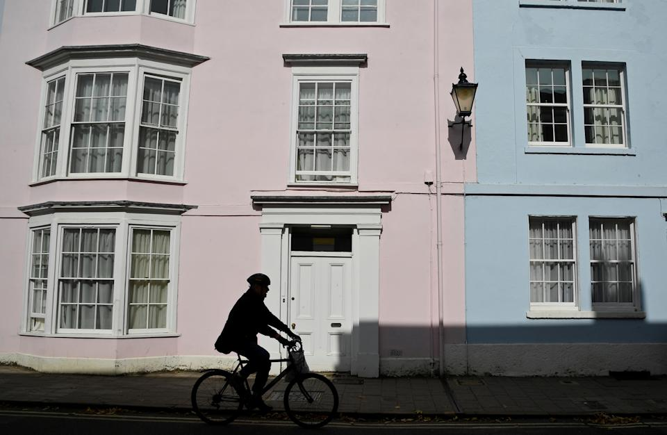 A man is silhouetted as he cycles through the city centre amidst the coronavirus disease (COVID-19) pandemic, in Oxford, Britain, September 17, 2020. REUTERS/Toby Melville