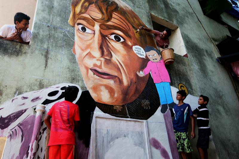 Artists paint wall mural of Mogamboo of Hindi cinema