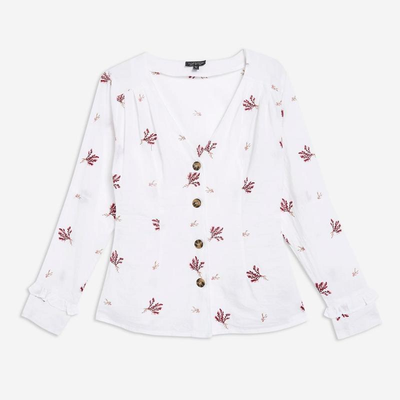 """<a rel=""""nofollow noopener"""" href=""""https://go.redirectingat.com?id=86205X1579268&xs=1&url=http%3A%2F%2Fus.topshop.com%2Fen%2Ftsus%2Fproduct%2Fnew-in-this-week-2169940%2Fnew-in-fashion-6367520%2Fembroidered-button-down-blouse-7824987%3Fbi%3D40%26ps%3D20%26geoip%3Dnoredirect%26network%3Dlinkshare%26utm_source%3Dlinkshare%26utm_medium%3Daffiliate%26utm_campaign%3DUS_2400842%26utm_content%3D%253CLSNLNKTYPENAME%253E%26siteID%3D30KlfRmrMDo-_2fFRLRjJ5i4pedPenB7qw%26cmpid%3Daff_lsus_30KlfRmrMDo_10%26_%24ja%3Dtsid%3A21416%7Cprd%3A30KlfRmrMDo"""" target=""""_blank"""" data-ylk=""""slk:Embroidered Button Down Blouse, Topshop, $68"""" class=""""link rapid-noclick-resp"""">Embroidered Button Down Blouse, Topshop, $68</a>"""