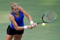 Shelby Rogers, of the United States, returns a shot to Petra Kvitova, of the Czech Republic, during the fourth round of the US Open tennis championships, Sunday, Sept. 6, 2020, in New York. (AP Photo/Seth Wenig)