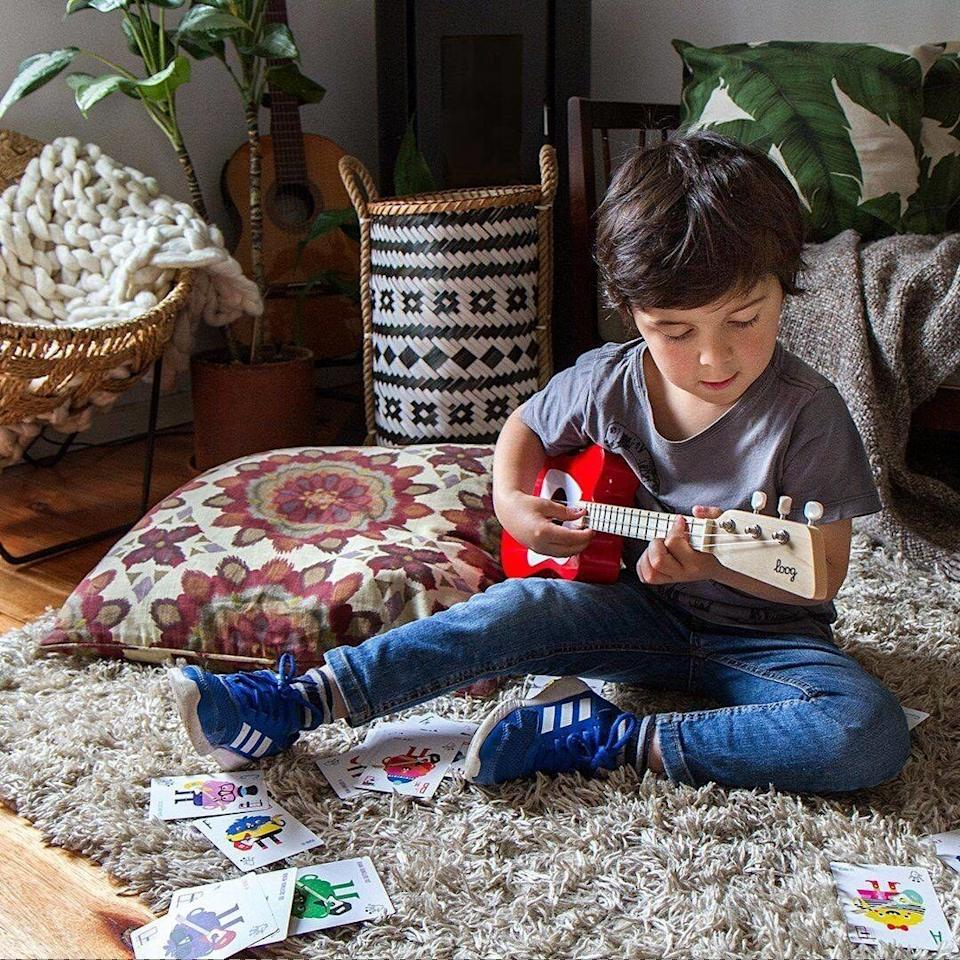 """Start teaching your little punk kid the entire Ramones catalog. This toy comes with flashcards of chord diagrams and full access to the Loog Guitar app. Hey! Ho! Let's go!<br /><br /><strong>Promising review:</strong>""""My daughter and I learning how to play the guitar together. Even if we don't become rock stars the quality time we are spending together is all the justification I needed to make the purchase. The strings are perfect for her little fingers."""" —<a href=""""https://amzn.to/3xhjcOF"""" target=""""_blank"""" rel=""""noopener noreferrer"""">JSpriggins</a><br /><strong><br />Get it from Amazon for<a href=""""https://amzn.to/3xkkEQb"""" target=""""_blank"""" rel=""""noopener noreferrer"""">$79</a>(available in six colors).</strong>"""