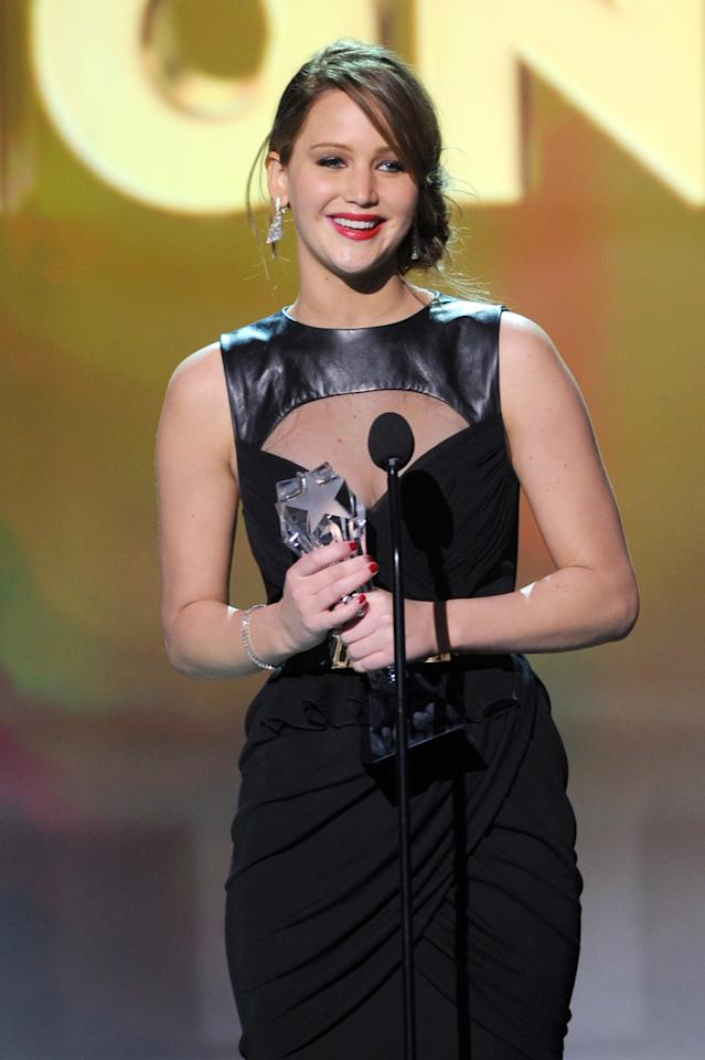 "SANTA MONICA, CA - JANUARY 10:  Actress Jennifer Lawrence accepts the Best Actress in an Action Movie Award for ""The Hunger Games"" onstage at the 18th Annual Critics' Choice Movie Awards held at Barker Hangar on January 10, 2013 in Santa Monica, California.  (Photo by Kevin Winter/Getty Images)"