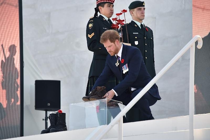 Britain's Prince Harry lays a pair of boots in tribute to the troops who lost their lives in Vimy (AFP Photo/Philippe HUGUEN)