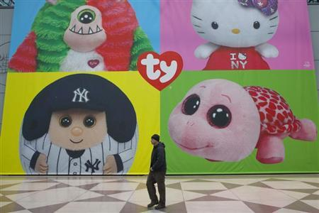 A man walks past a display for Ty Beanie Babies products at Toy Fair 2013