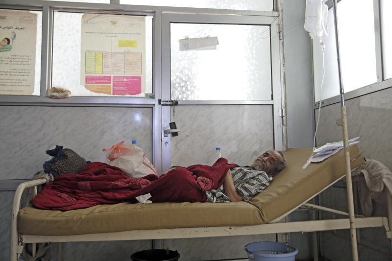 FILE - In this Thursday, March 28, 2019 file photo, a man is treated for suspected cholera infection at a hospital in Sanaa, Yemen. Cholera is surging once more in Yemen, with more than 76,000 suspected new cases and 195 deaths in March, double the number in the previous two months, according to U.N. figures. Doctors point to the difficulty in controlling epidemics in a country where infrastructure has been decimated by four years of war. (AP Photo/Hani Mohammed, File)