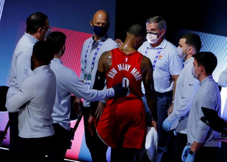 Injured Blazers star Lillard vows to play on against Lakers