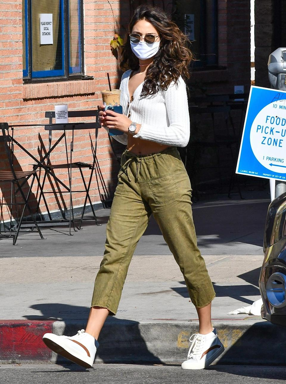 <p>Eiza González grabs coffee from Alfred in Studio City on Thursday.</p>