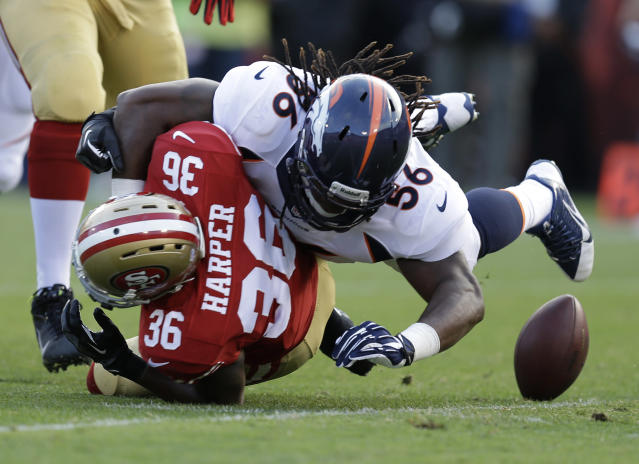San Francisco 49ers running back D.J. Harper (36) fumbles the ball while being hit by Denver Broncos linebacker Nate Irving, right, during the second quarter of an NFL preseason football game on Thursday, Aug. 8, 2013, in San Francisco. Broncos' Shaun Phillips recovered the ball for a touchdown. (AP Photo/Ben Margot)