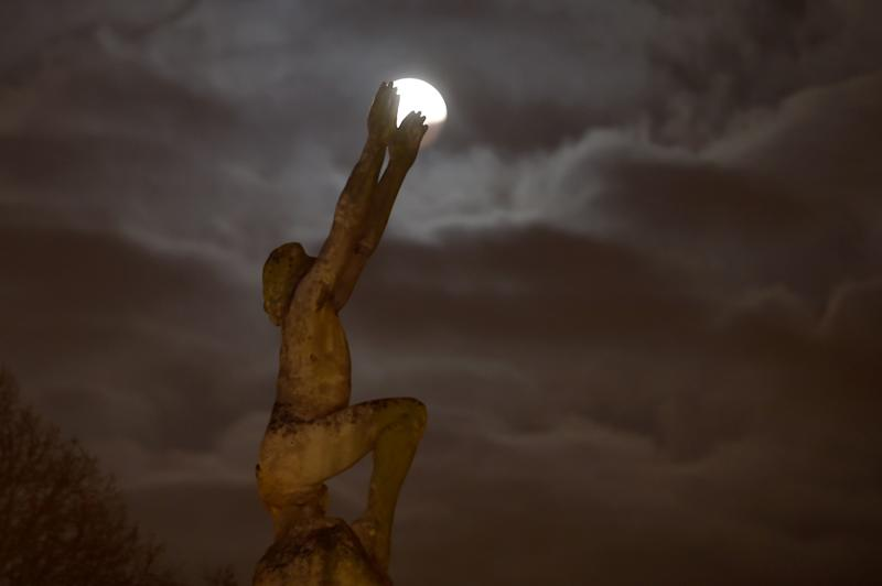 "The super blood moon in Le Mans, France, behind the statue ""L'envol"" (""The Takeoff"") Jan. 21."
