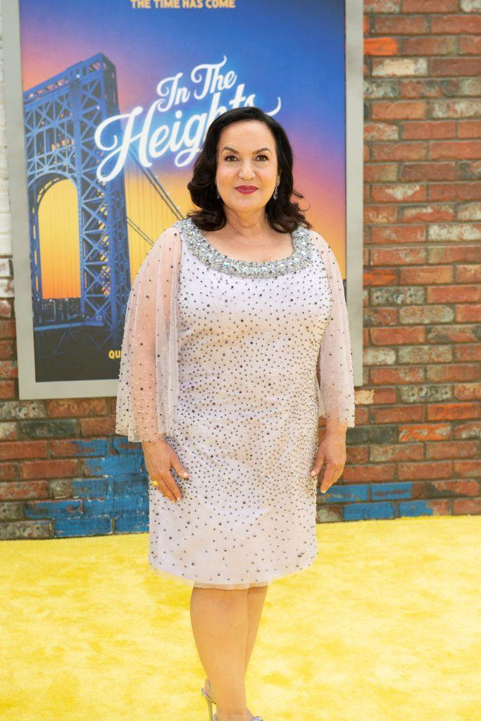 """<p>Olga Merediz who reprises her role as Abuela Claudia, has been involved with <em>In the Heights</em> from the very beginning. Before the musical hit <em>became</em> a hit, she told <em><a href=""""https://ew.com/movies/in-the-heights-olga-merediz-interview/"""" rel=""""nofollow noopener"""" target=""""_blank"""" data-ylk=""""slk:Entertainment Weekly"""" class=""""link rapid-noclick-resp"""">Entertainment Weekly</a> </em>that she worked with Lin-Manuel Miranda during the readings and workshops in the early 2000s. Merediz plays the neighborhood matriarch and wonderfully sings """"Paciencia y Fe.""""</p><p><strong>Follow her on Instagram: </strong>@officialolgamerediz</p>"""